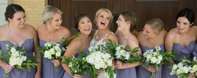 laughing bridesmaids purple gowns