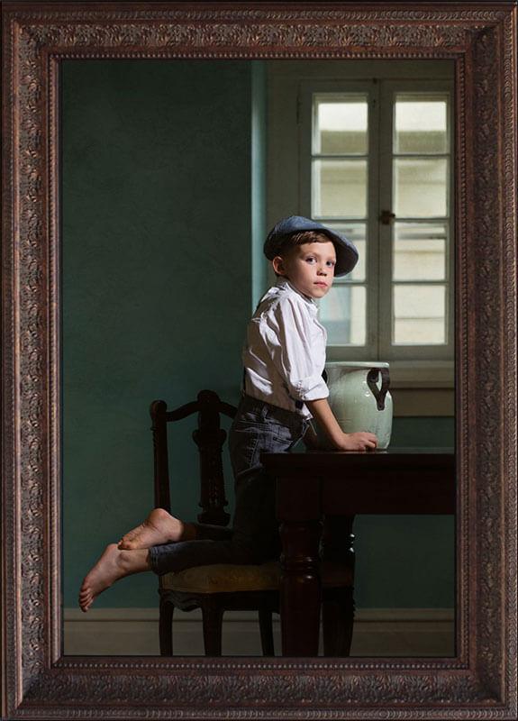 fine art portrait of little boy in blue room