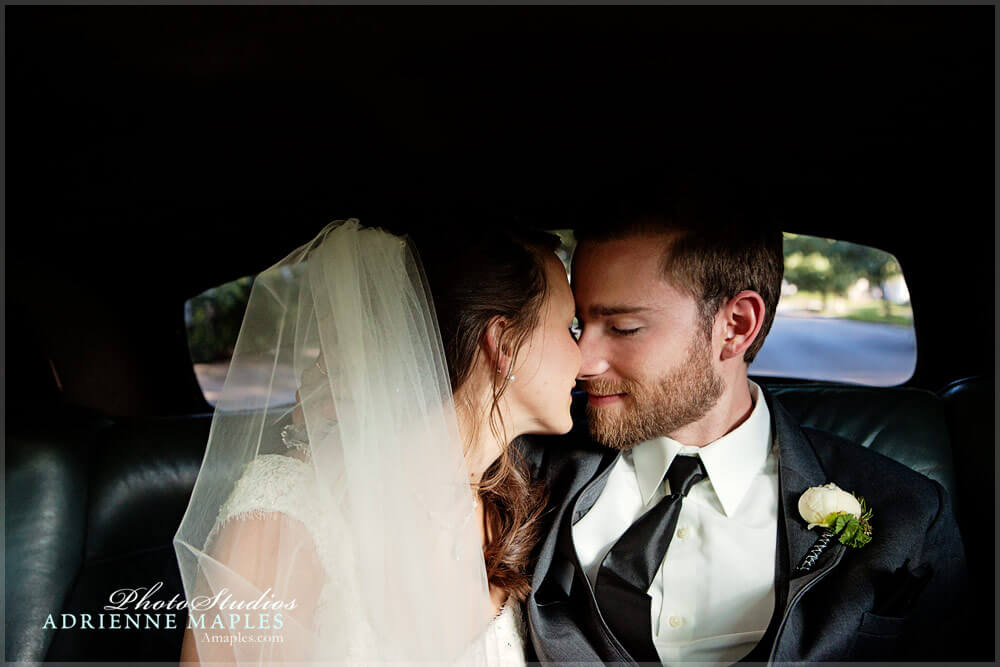 photo moment bride groom kiss in car