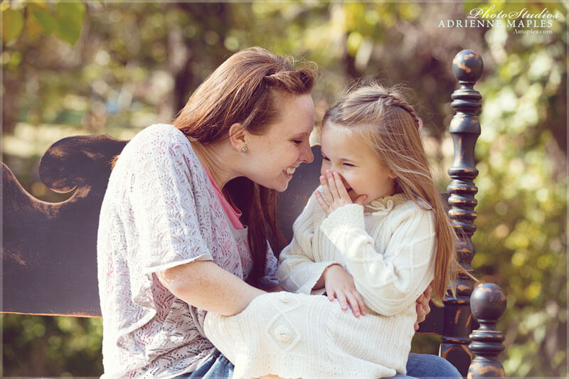 daughter and mom laughing together