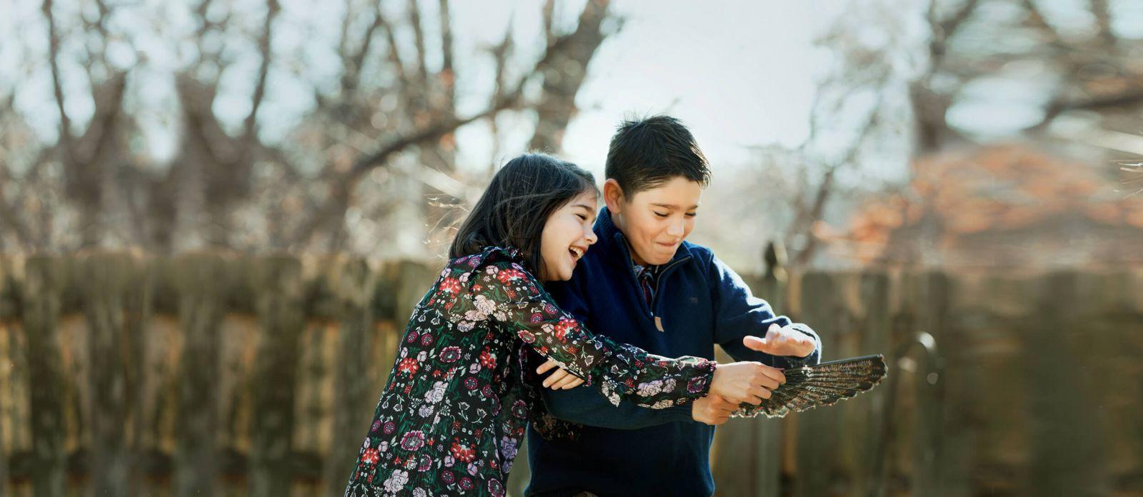 photograph children laughing playing having fun