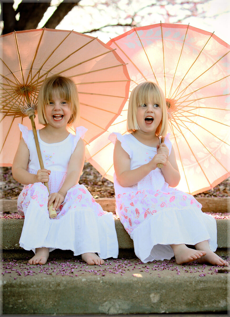 fine art portrait twin girls pink parasols