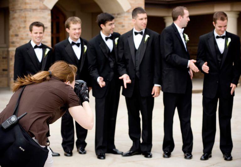 wedding photographer photographing groomsmes